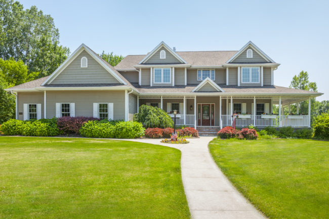 gray-house-with-green-lawn-e1478724365131.jpg